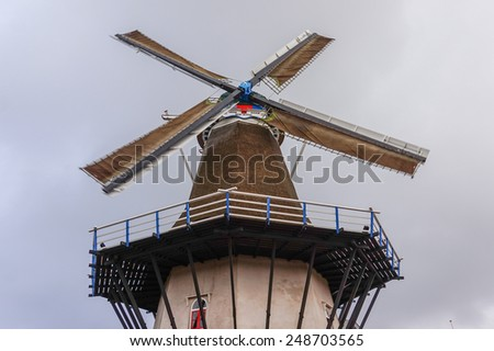 Fully Operational Historic Windmill in Ermelo the Netherlands with Blades at forty five degrees - stock photo