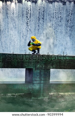 fully protected in uniform,boots,gloves and mask scientist examinig toxic substance in contaminated area - stock photo