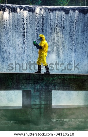 fully protected in uniform,boots,gloves and mask scientist examining toxic substance in contaminated area - stock photo