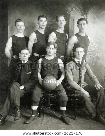 FULTON, NY - CIRCA 1906:  An old photograph of a basketball team with vintage uniforms and equipment pose for a team photograph in Fulton, NY, circa 1906. - stock photo