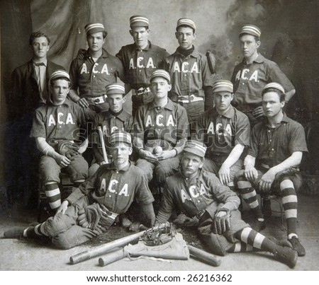 FULTON, NY - JUNE 5, 1903:  An old photography of a baseball team in period uniforms with turn of the century equipment pose for a team photograph on June 5, 1903 in Fulton, NY. - stock photo