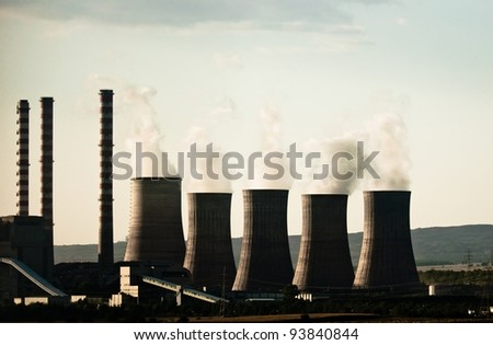 Fumes coming out of power plant - stock photo
