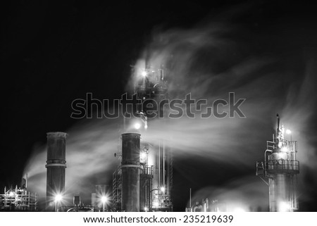 Fumes from an old oil plant . - stock photo