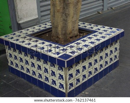 Fun and beautiful big tile tree pot cover in the city of Mexico