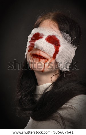 fun attractive girl with blood smiling