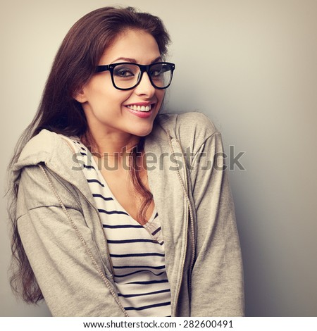 Fun beautiful woman in glasses with happy smile. Vintage closeup portrait - stock photo
