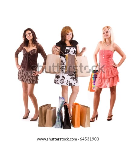 fun beauty adult girls out shopping with colored bags, standing full. Isolated on white. - stock photo