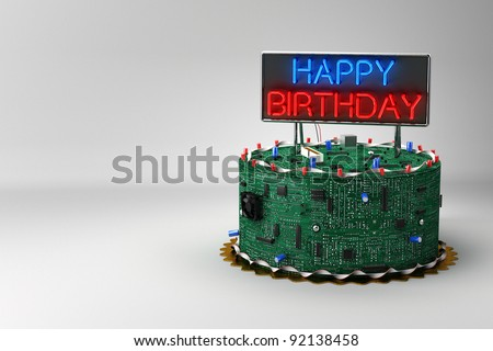 Fun birthday cake for geeks with electronic components - stock photo