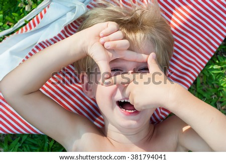 Fun Boy Lies Green Grass Make Picture Frame Hands Summer Background - stock photo