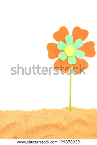 fun bright flower in the sand of the sea - stock photo