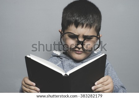 fun, dark-haired young student reading a funny book, reading and learning