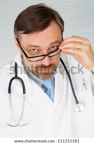 Fun doctor is receiving visitors in his office