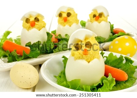 Fun Easter breakfast of hatching chicks made of boiled eggs                     - stock photo