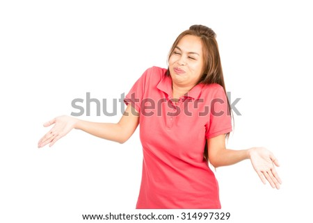Fun, easy going Asian woman in casual clothes with hands out bursting laughing, shrugging shoulders with unsure, apathetic, indecisive or I don't know attitude - stock photo