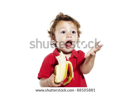 fun expression child with banana - stock photo
