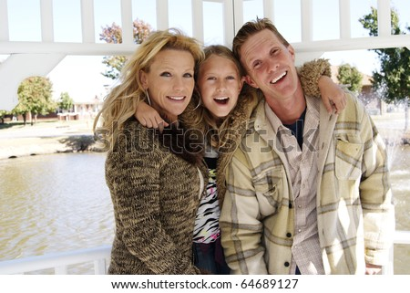 Fun family day at the park - stock photo