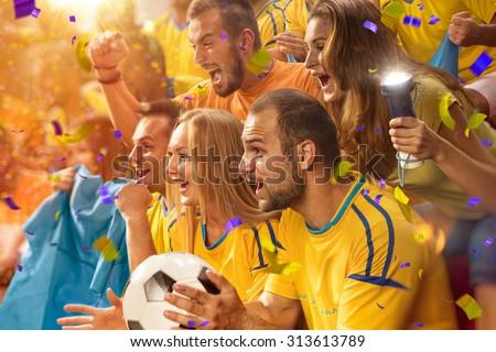 Fun Fans in stadium arena - stock photo