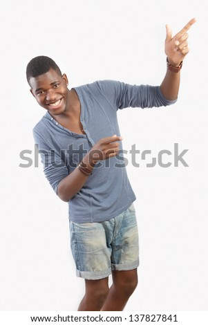Fun gesture, young man laughing pointing - stock photo
