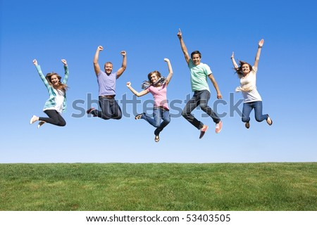 Fun Group of Young People Jumping Outdoors