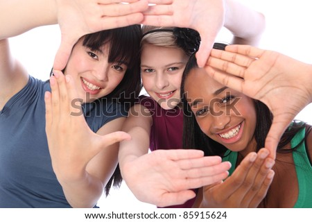 Fun hand sign by three multi cultural teenage school student friends made up of mixed race african american, oriental Japanese and caucasian all happy holding hands out to camera. - stock photo