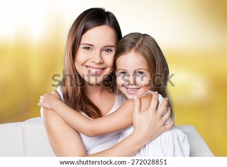 Fun. Happy family. Mother and baby daughter plays at home on the sofa - stock photo