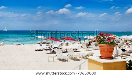 Fun in sand & and water on Seven Mile Beach, Grand Cayman - stock photo