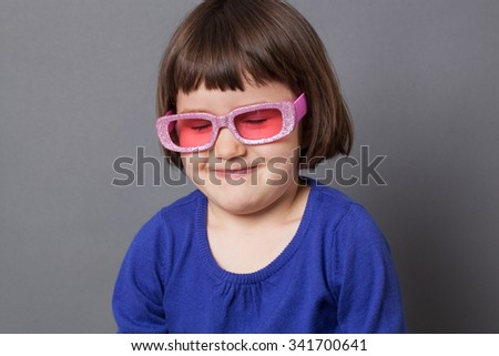fun kid glasses concept - laughing preschool child proud of wearing sparkling pink glasses for comic disco outfit or positive future,studio shot - stock photo