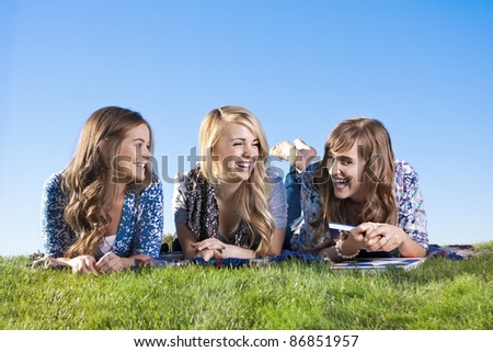 Fun-loving and laughing women playing outside together - stock photo