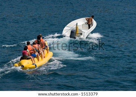 Fun on a banana boat on the Mediterranean coast of Turkey - stock photo