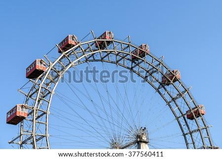 Fun Park Ferris Wheel Against Blue Sky In Vienna Prater Fun Park - stock photo