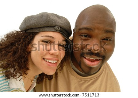 Fun portrait of a cool, attractive young couple taken with a wide angle lens for a fun distortion - stock photo