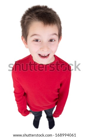 Fun portrait of a laughing young boy looking up at the camera taken full length from a high angle perspective isolated on white - stock photo