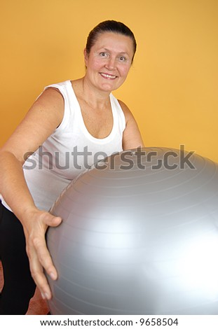 Fun portrait of an older woman working out - stock photo