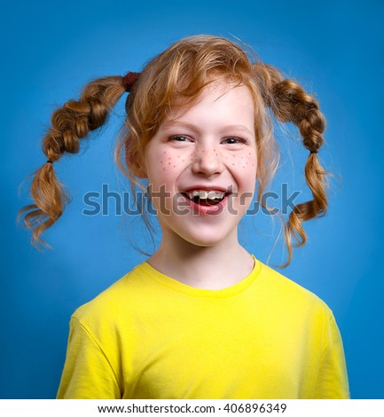 Fun redhead girl with pigtails. - stock photo