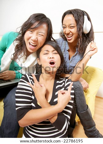 Fun, slightly distorted shot of teens hanging out and playing music - stock photo