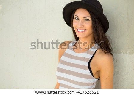 Fun stylish portrait headshot of a young female hipster hip trendy fashion style pretty brunette  - stock photo