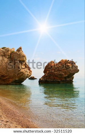 Fun sun and bay with big cliffs. - stock photo