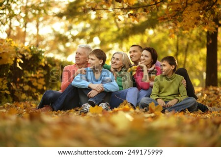 fun walk a large family in the autumn forest - stock photo