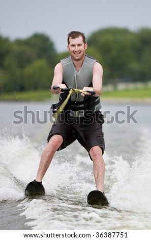 Fun water-skiing on a lake - stock photo