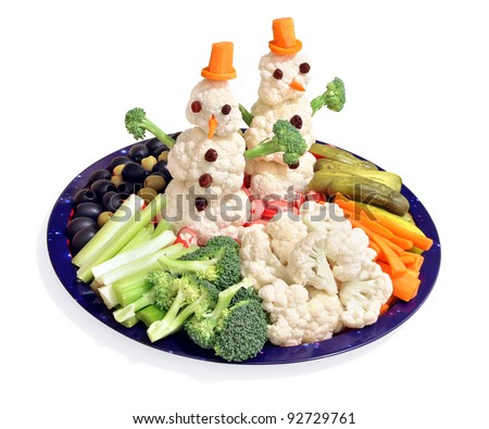 Fun way for kids to eat vegetables! Themed for winter holidays with cauliflower snowmen. - stock photo