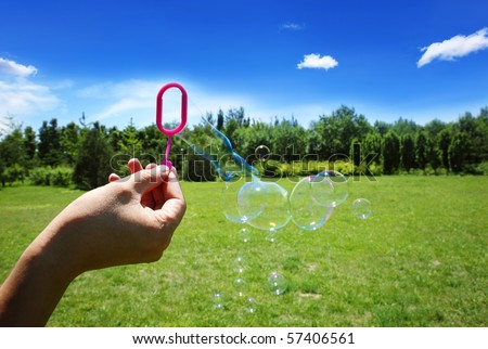 fun with bubble soap toy at sunny day