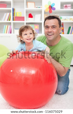 Fun with dad - little boy playing with his father at home - stock photo
