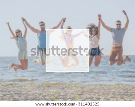 Fun with friends. Group of happy young people holding hands and jumping with sea in the background  - stock photo