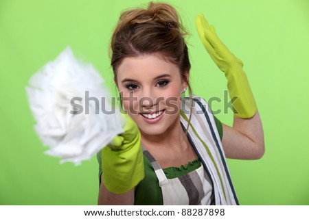 Fun woman doing household chores - stock photo