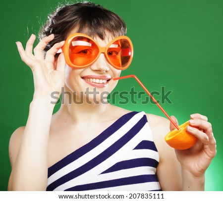 fun woman with oranges over green background