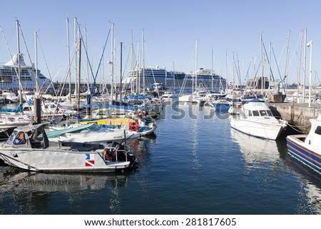 FUNCHAL, MADEIRA - APRIL 22, 2015:Yachts moored in Funchal seaport, Madeira island, Portugal. - stock photo