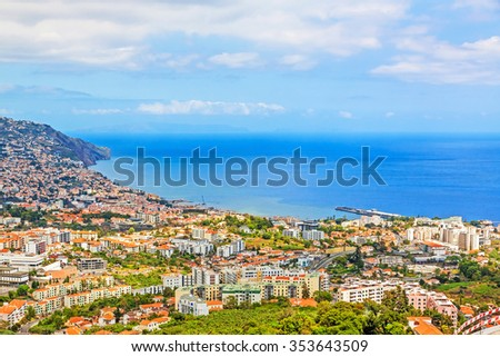 Funchal, Madeira - June 7, 2013: South coast of Funchal -view over the capital city of Madeira towards harbor. View from Pico dos Barcelo - Atlantic Ocean in the background.