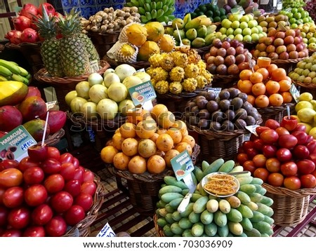 Funchal, Portugal - August 24, 2017: Assortment of local fruits lay on the counter. Central marketplace of Madeira island