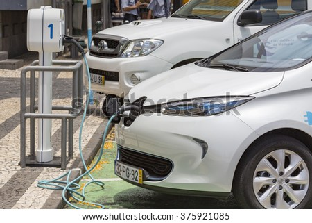 FUNCHAL, PORTUGAL - JUNE 25:Cable hanging down from gas tank location on electrical vehicle on June 25, 2015 in Funchal, Madeira island, Portugal.  - stock photo