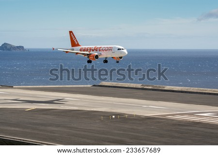 FUNCHAL, PORTUGAL - Nov 13: Passenger plane from airline easyJet lands on Funchal Airport on November 13, 2014 at Madeira, Portugal - stock photo